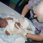 A severely dehydrated baby is treated.